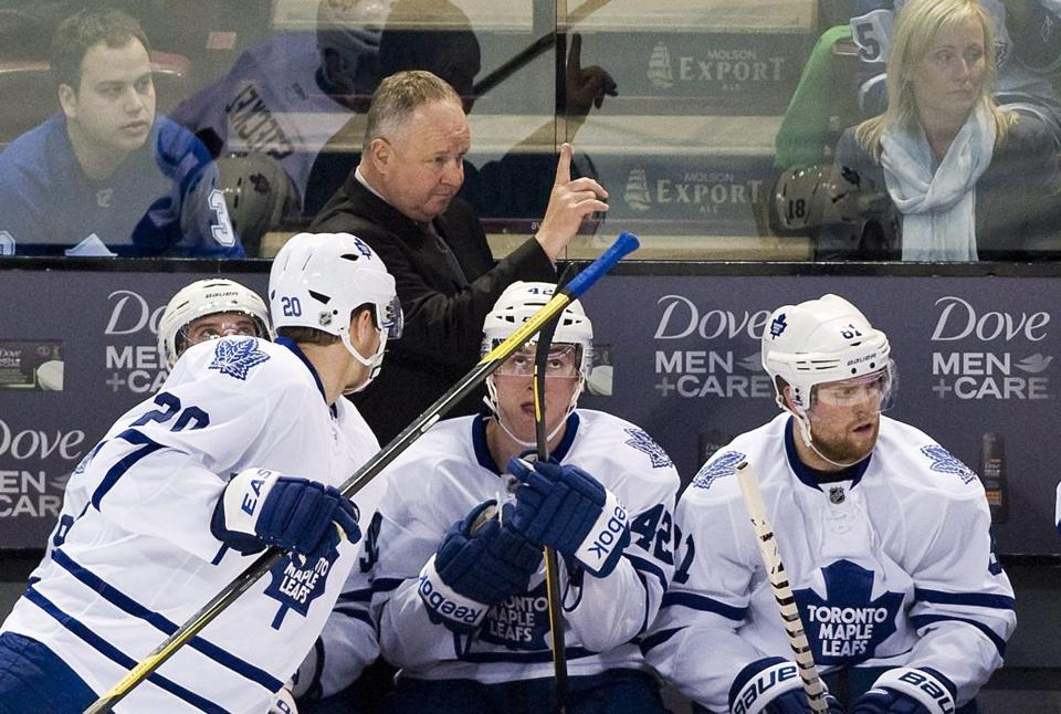 The Maple Leafs fired Ron Wilson Friday night and hired Randy Carlyle (above), the former Toronto defenseman who was fired by Anaheim in December.