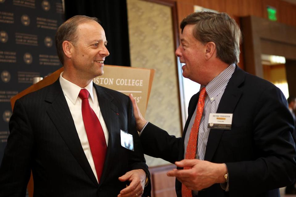 Sanofi chief executive Christopher A. Viehbacher (left) , the keynote speaker at The Boston College Chief Executives' Club of Boston, talked with Henri A. Termeer (right) former chief executive officer of Genzyme Corp.