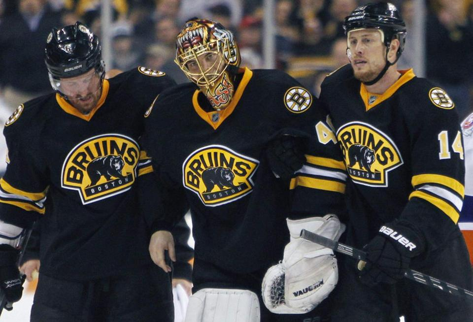 Tuukka Rask (center), who was diagnosed with a lower abdomen/groin strain, was helped off the ice by Greg Zanon (left) and Joe Corvo Saturday.