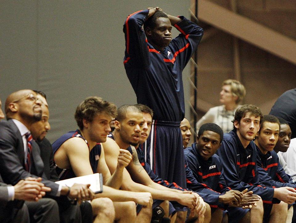 The Penn bench  - including Dau Jok (standing)  - watches a chance at an Ivy League title (and NCAA berth) slip away in a loss to Princeton.