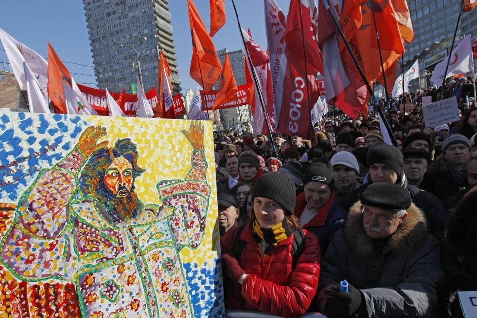 Protesters held a placard depicting Czar Ivan The Terrible Saturday in Moscow.