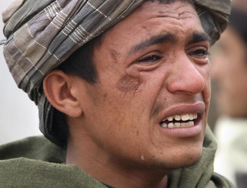 An Afghan civilian mourned for relatives reportedly killed in an attack launched by a US Army staff sergeant on Sunday.