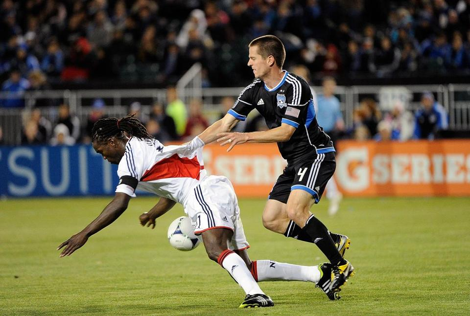 To get control of the ball, Sam Cronin of the San Jose Earthquakes pushed Shalrie Joseph to the turf.