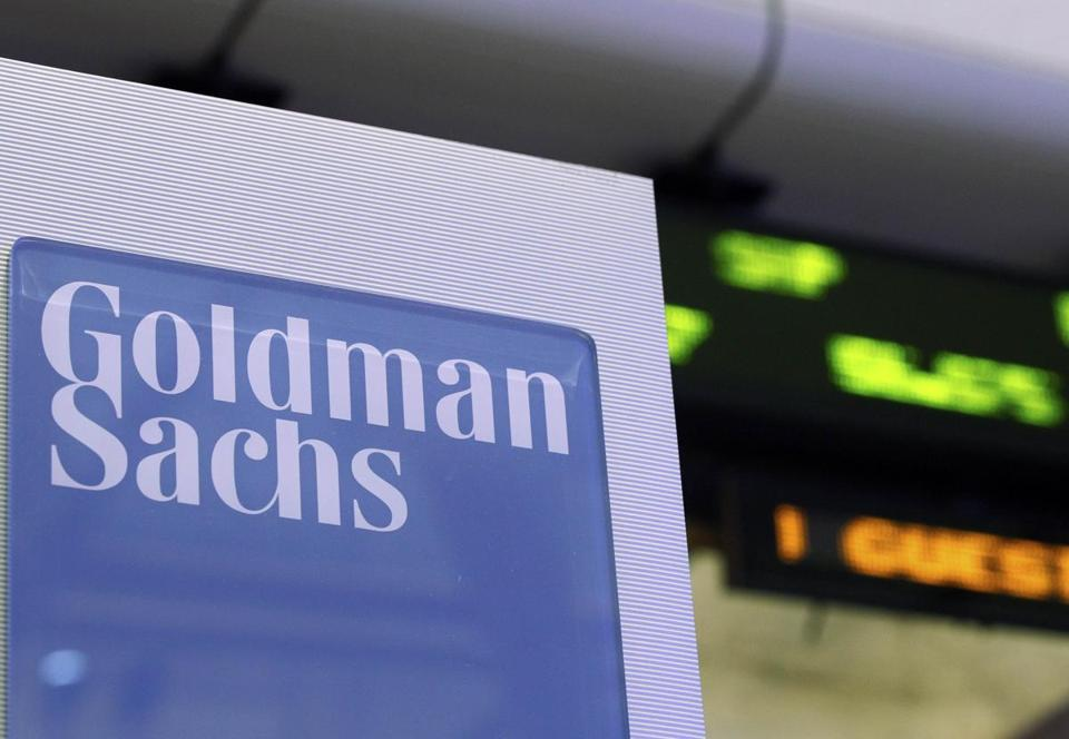 A Goldman Sachs sign on at the company's post on the floor of the New York Stock Exchange.
