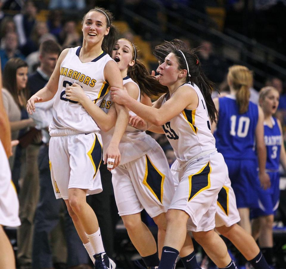 Andover's Nicole Boudreau was mobbed by teammates, including Ally Fazio and Jackie Alois, after she hit a three pointer in the team's semifnal win over Braintree March 13.