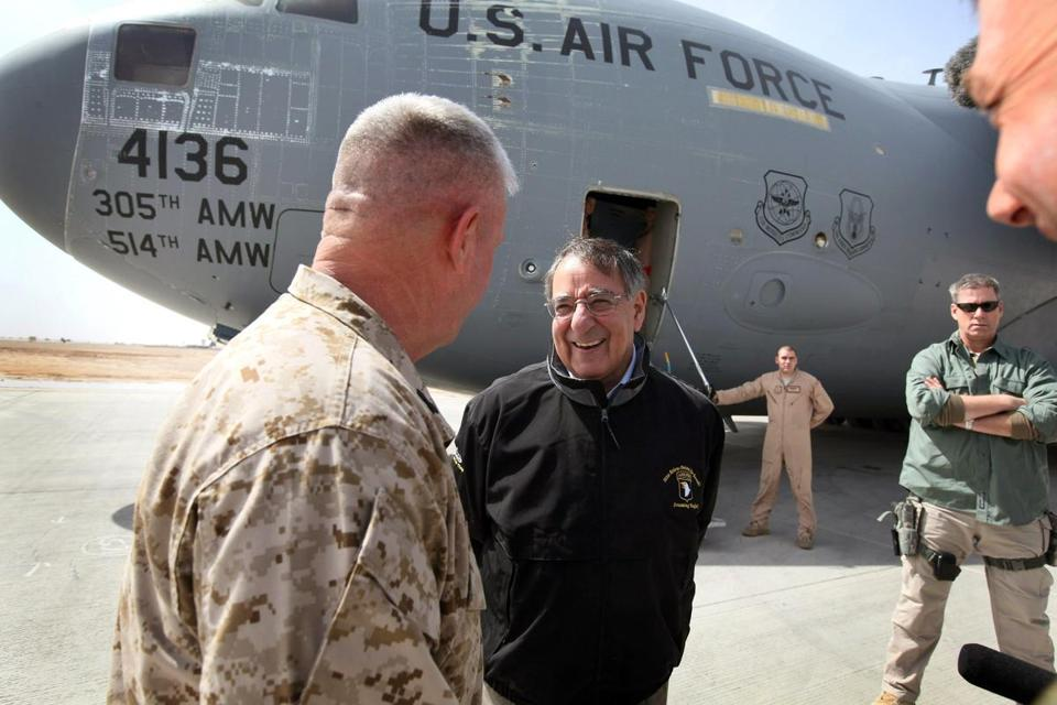 U.S. Defense Secretary Leon Panetta is greeted after arriving at Camp Bastion, where an Afgan drove a stolen, flaming vehicle onto a runway ramp as the secretary's plane landed Wednesday.