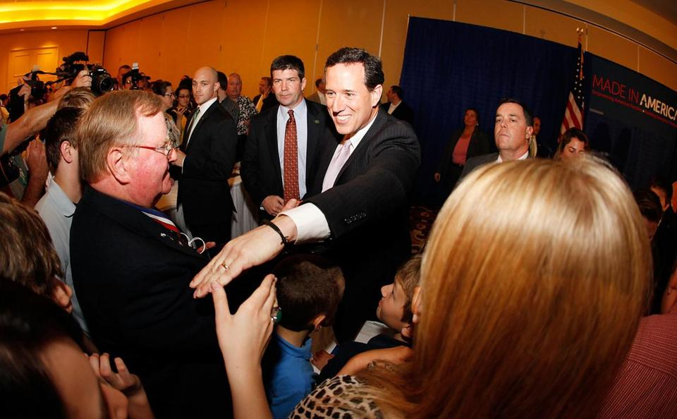 Republican presidential candidate Rick Santorum addresses supporters in Lafayette, Louisiana after winning the both Alabama and Mississippi primaries on Tuesday.