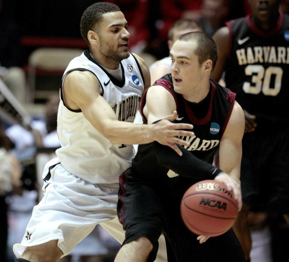 Vanderbilt forward Jeffery Taylor pressured Harvard guard Laurent Rivard during the first half in Albuquerque, N.M., Thursday. Rivard finished with a team-high 20 points in the loss.