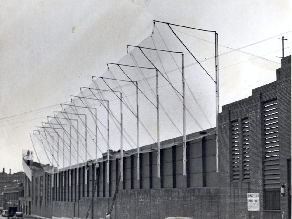 Nets were installed above the left field wall at Fenway Park.