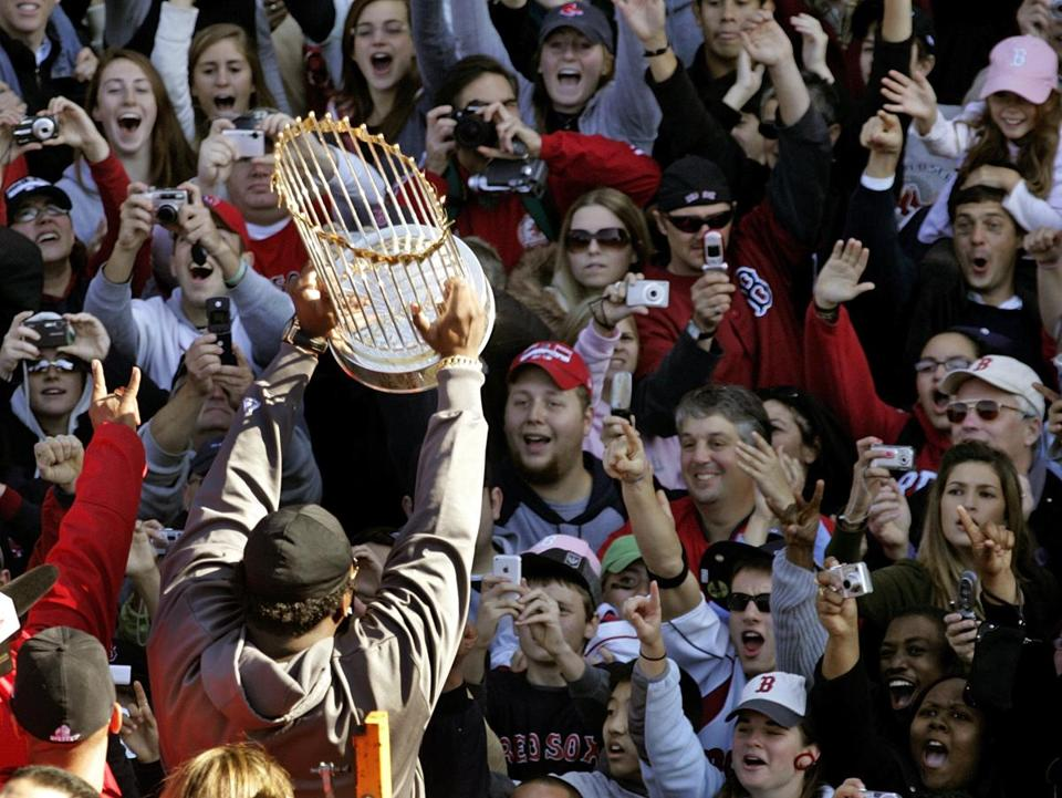 David Ortiz showed off the World Series trophy to some of the thousands of fans who turned out to celebrate the Red Sox.
