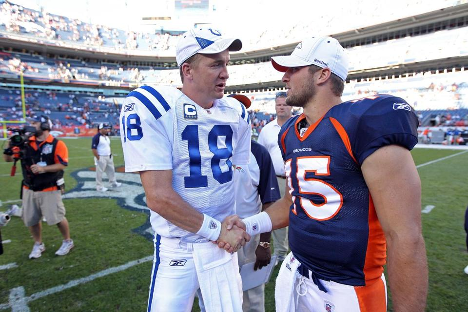 Peyton Manning, shown with Broncos quarterback Tim Tebow in Sept. 2010, will be wearing a Broncos uniform the next time he takes the field in Denver.