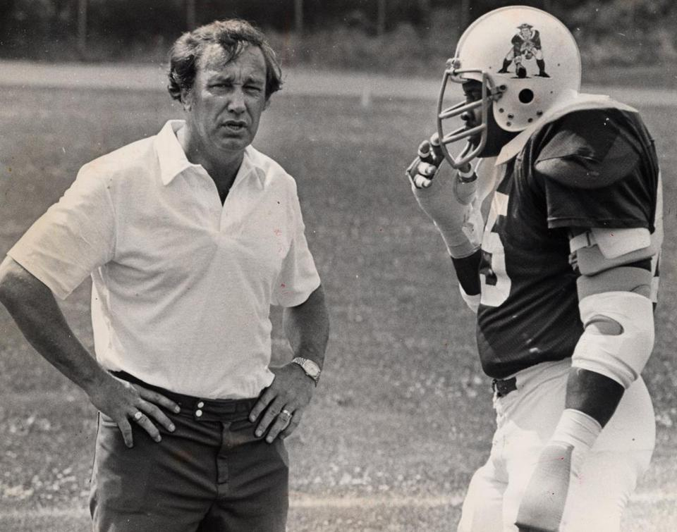 Ron Erhardt, left, with Julius Adams during his time as Patriots coach in 1979.