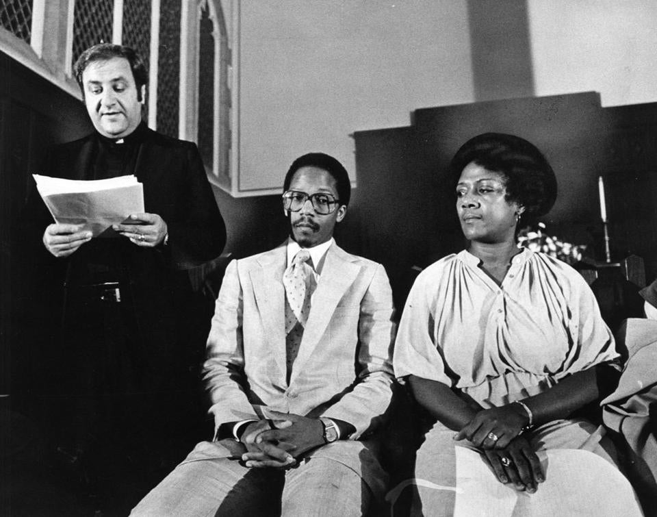 Boston Globe Staff Photo Stan Grossfeld. September 30, 1979, Roxbury Elliot - Congragational Church. left to right. Father Ernest Serino, Reverend Charles Stith, Shirley Simmons