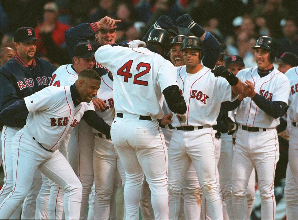 Teammates were happy to greet Mo Vaughn at home after his game-winning grand slam.