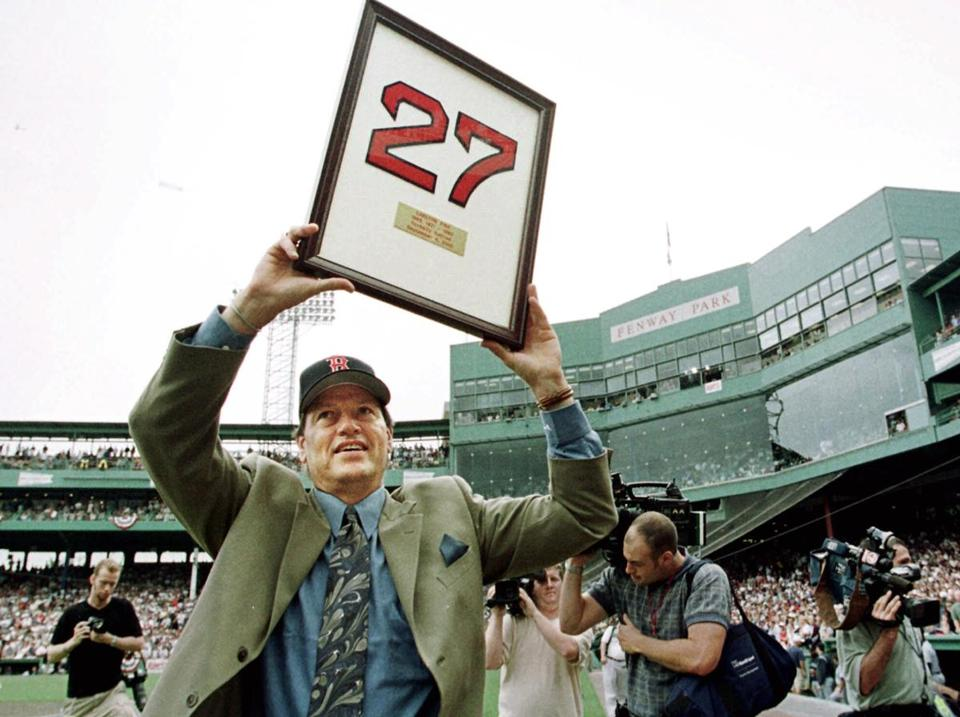 Carlton Fisk showed his newly retired No. 27 to Fenway Park fans.