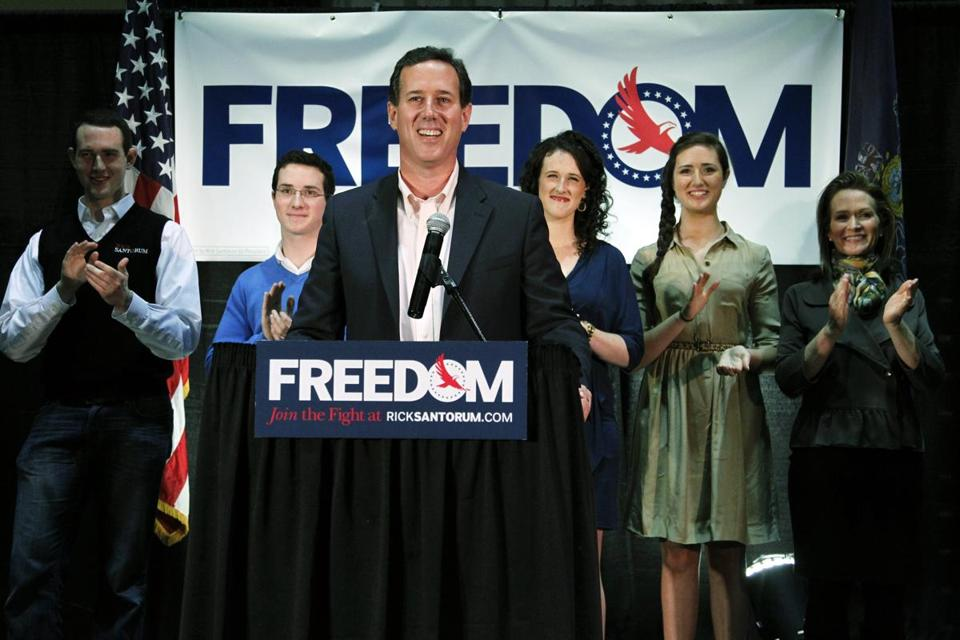Republican presidential candidate Rick Santorum, accompanied by family members, speaks on Tuesday, March 20, in Gettysburg, Pa.