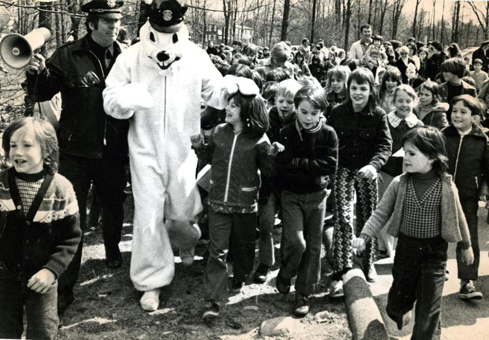 Patrolman Dennis Pearse of the Avon Police Department arrived, dressed as the Easter bunny, for the Easter egg hunt attended by more than 300 children.