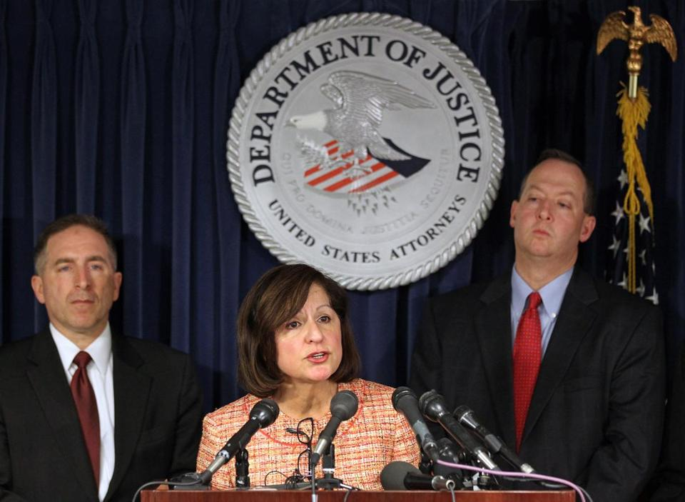 US Attorney Carmen M. Ortiz (center) announced indictments for three former top probation officials at the Moakley Federal Courthouse Friday. FBI ASPC James Burrell (left) and Chief of Public Corruption Brian Kelly (right) joined her.