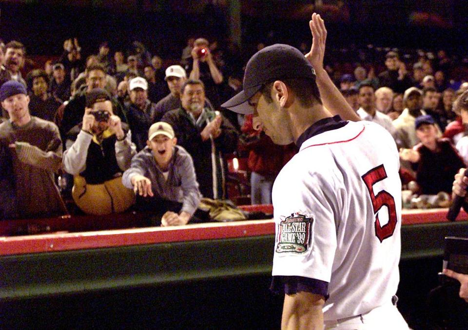 Fans stuck around to salute Nomar Garciaparra after he hit three home runs, including two grand slams, in a win over the Mariners on May 10, 1999.