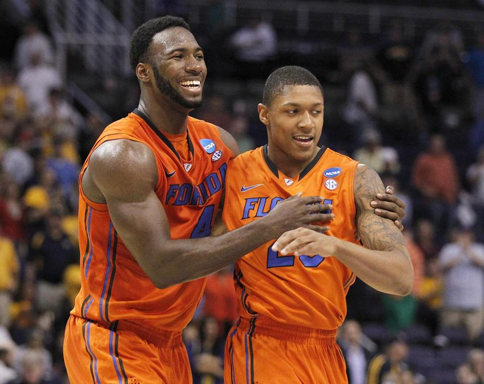 Florida's Patric Young, left, and Bradley Beal celebrated their victory over Marquette.