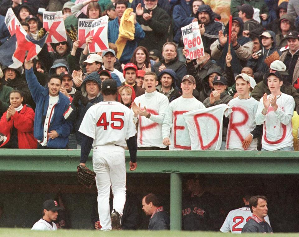 Pedro Martinez was cheered by fans as he walked back to the dugout after striking out the side against the Tampa Bay Devil Rays at Fenway Park on April 8, 2001. Martinez pitched eight innings, striking out 16 and giving up only three hits a 3-0 win.