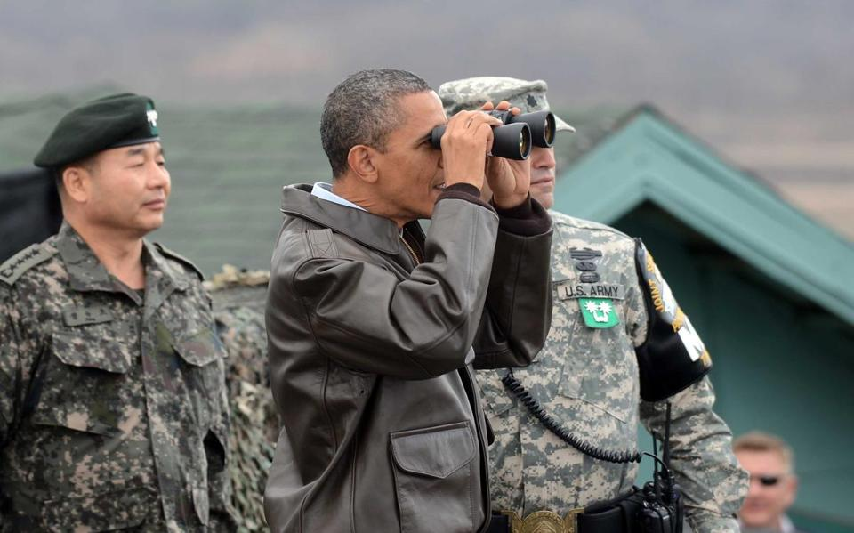 President Obama used binoculars to look at North Korea on Sunday from Observation Post Ouellette in the Demilitarized Zone, which separates the two Koreas in the inter-Korean truce village of Panmunjom.