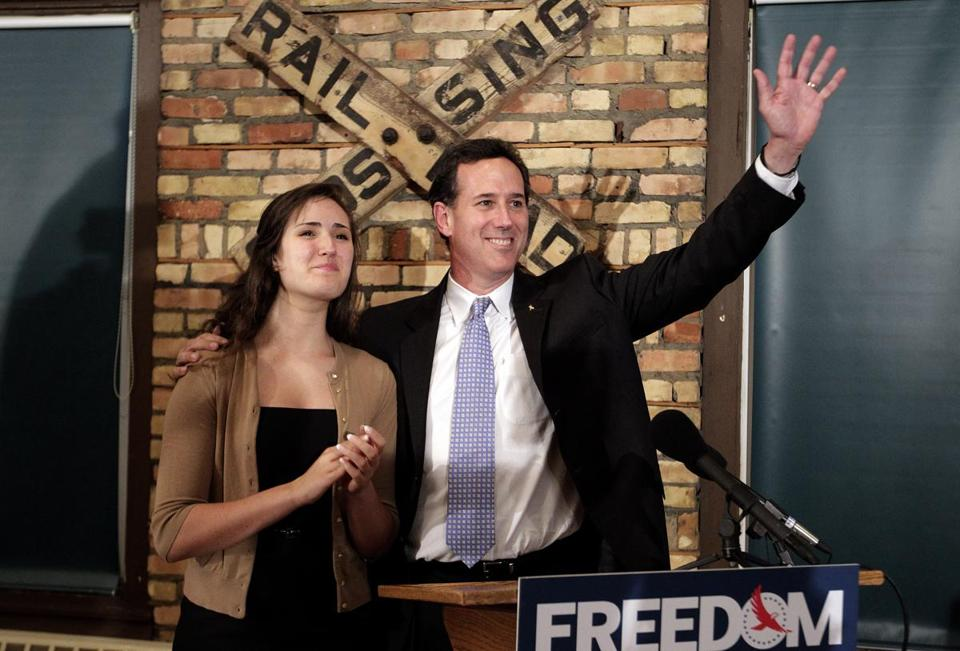 Republican presidential candidate Rick Santorum was joined by his daughter Sarah Maria during a news conference in Green Bay, Wis., after he won the Louisiana Republican presidential primary.