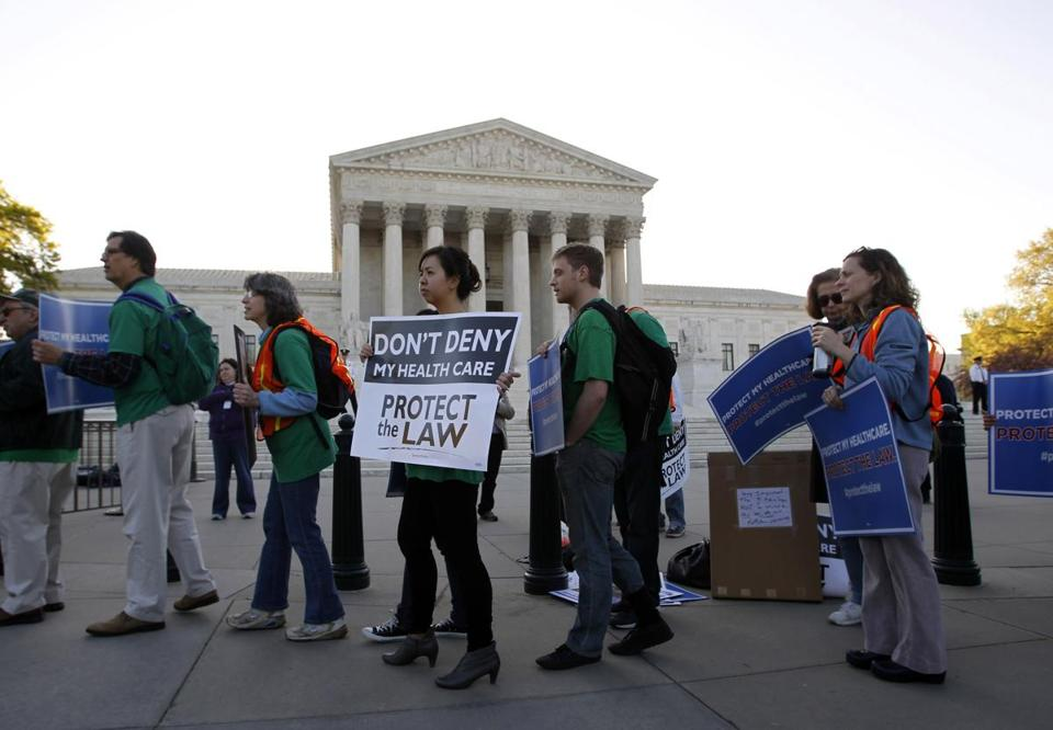 Supporters of President Obama's health care law, marched outside the Supreme Court on Monday.