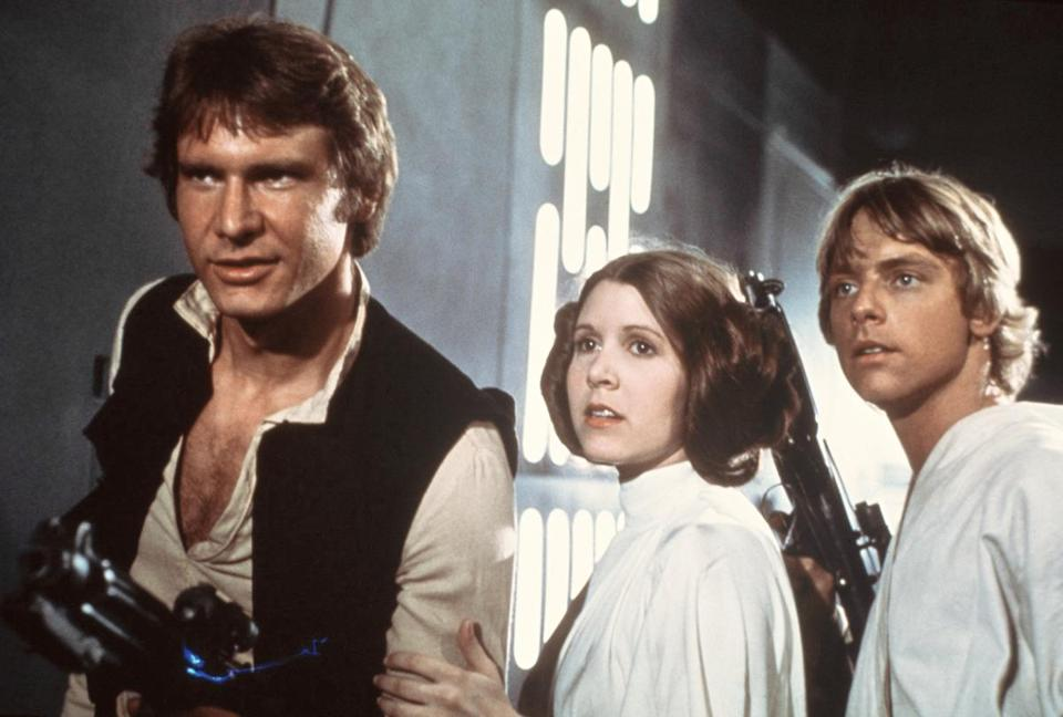 "Harrison Ford, Carrie Fisher, and Mark Hamill are in a scene from ""Star Wars."""