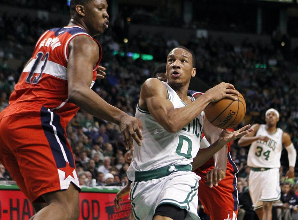 Avery Bradley drove past the Wizards' Kevin Seraphin in the second quarter.