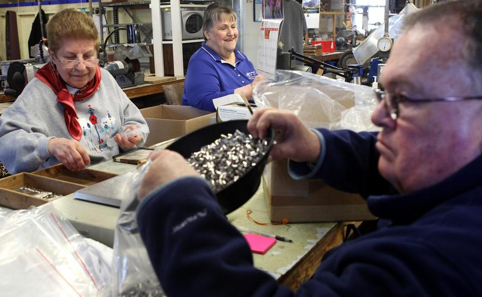 From left, Mary Brassard, 86, Dorrace Delaney, 74, and Roger Huff, 68, at work at Vita Needle Co. in Needham.