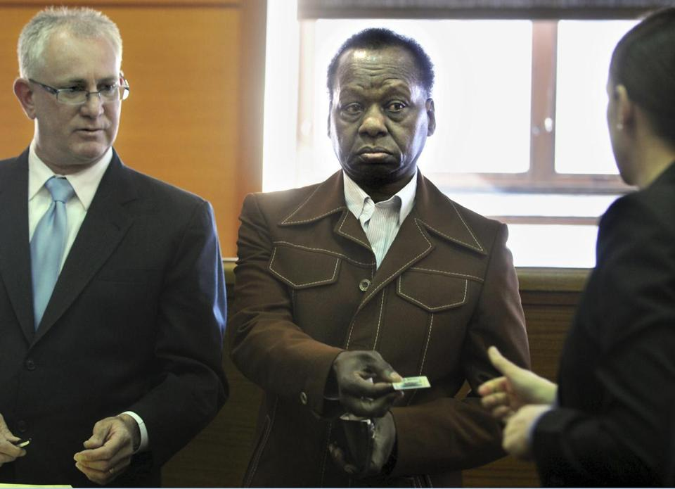 Onyango Obama, the uncle of President Obama, standing with his lawyer, P. Scott Bratton, surrendered his driver's license Tuesday in Framingham District Court.