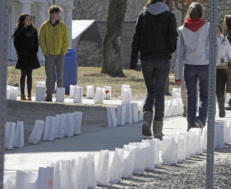 Students looked over luminaries in memory of teacher Melissa Jenkins on Tuesday at St. Johnsbury Academy in St. Johnsbury, Vt.
