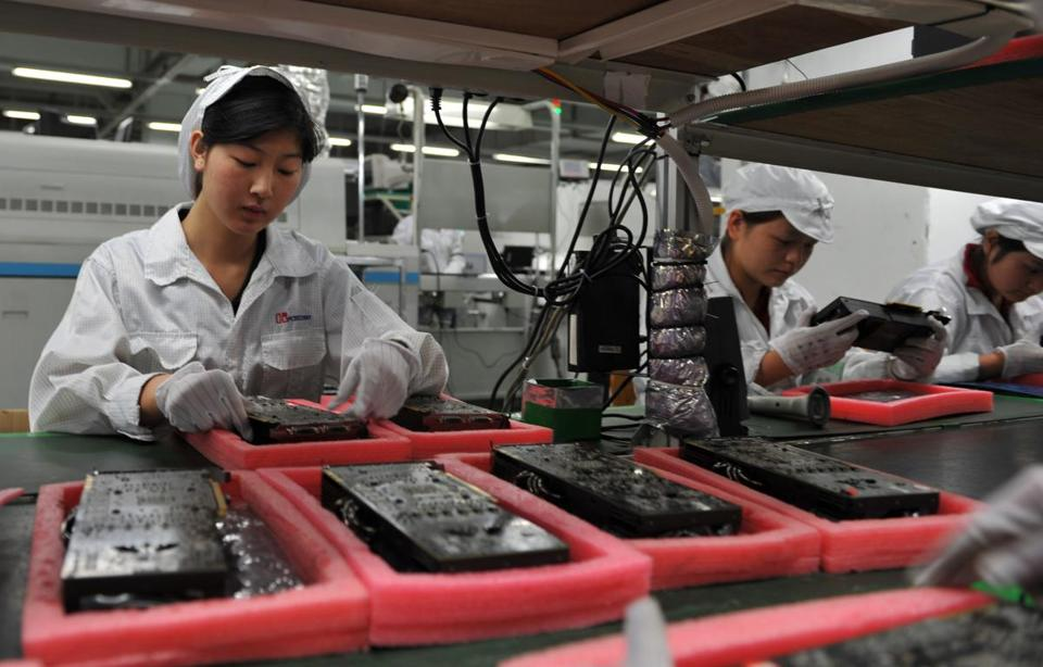 Workers inspected motherboards on a factory line at the Foxconn plant in Shenzen on May 26, 2010.