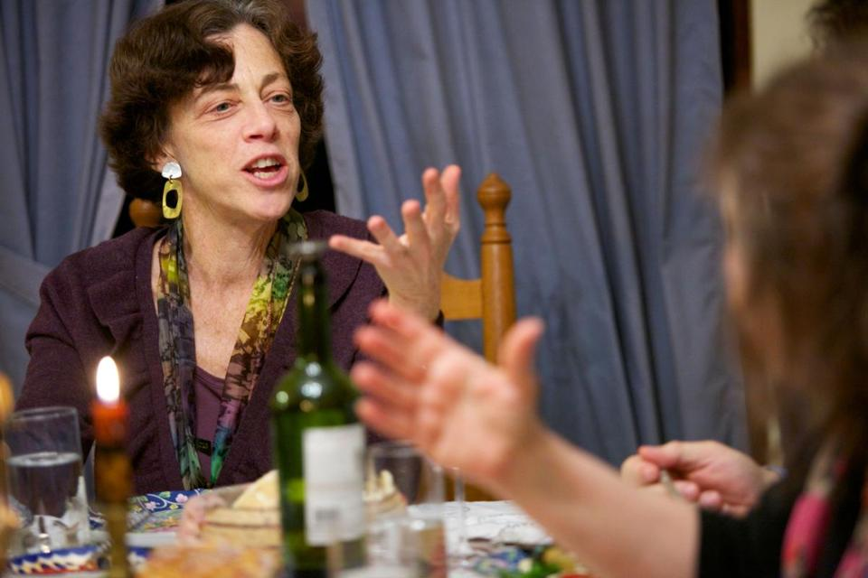 "Ann Silverman and members of her book club eat a Balkan meal while discussing the book, ""The Tiger's Wife."""