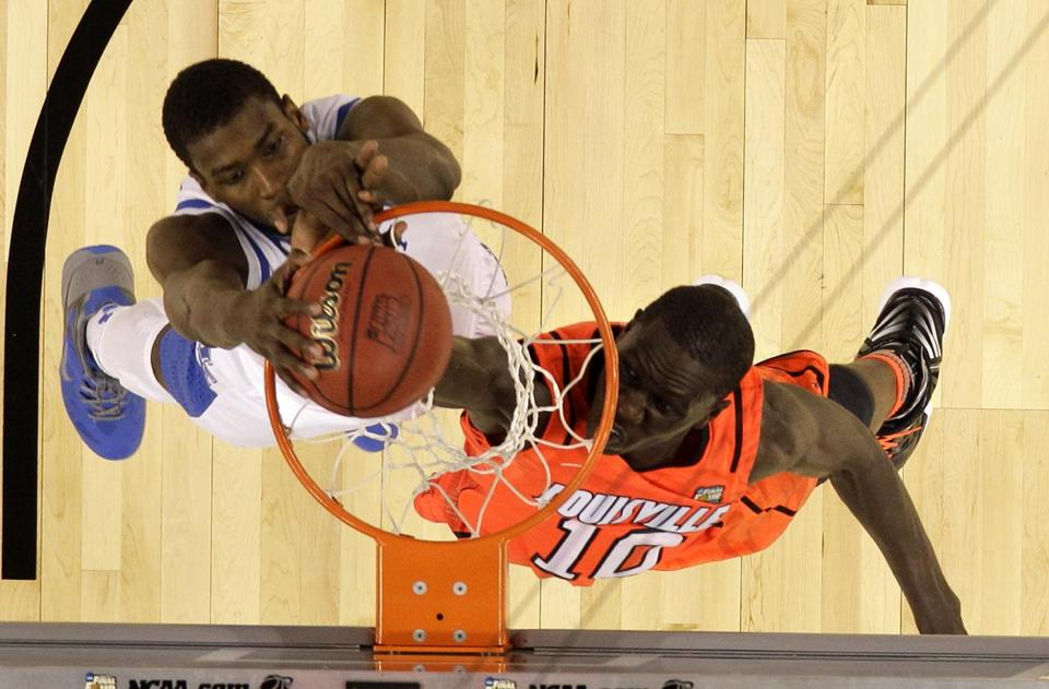 Kentucky forward Michael Kidd-Gilchrist slam dunked over Louisville center Gorgui Dieng during the second half of the NCAA Final Four semifinal college basketball tournament on Saturday.