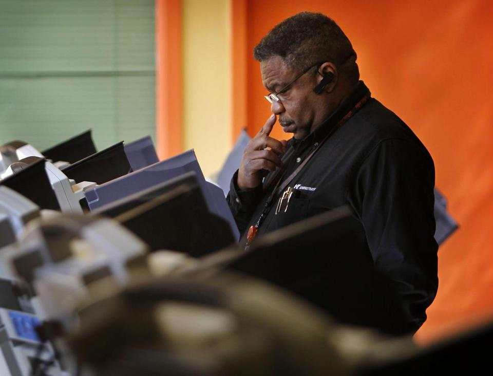 A voter in Tennessee ponders his choices on the ballot. (AP Photo/The Commercial Appeal, Jim Weber)