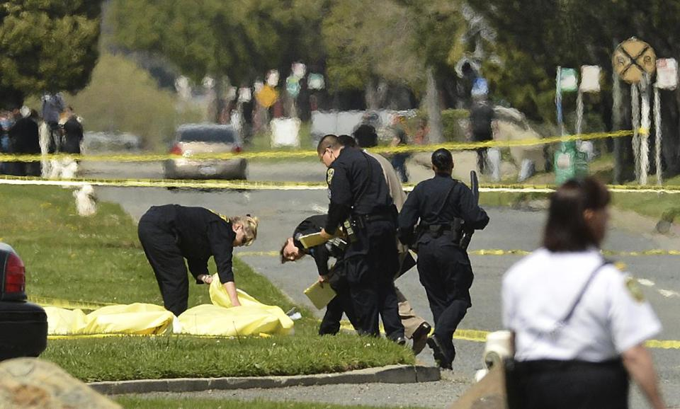 Police covered bodies after a man fatally shot at least seven people and wounded three Monday at Oikos University, a small Christian school in Oakland.