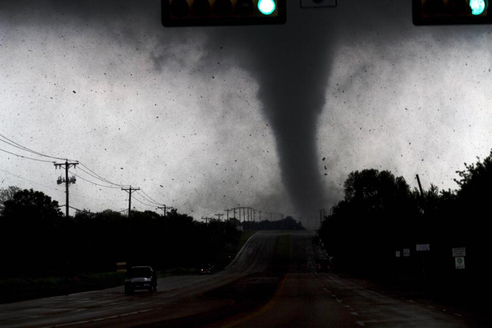 A tornado touched down in Lancaster, Texas, south of Dallas Tuesday. Tornadoes tore through the Dallas area, peeling roofs off homes, tossing big-rig trucks into the air, and leaving flattened tractor trailers strewn along highways and parking lots.