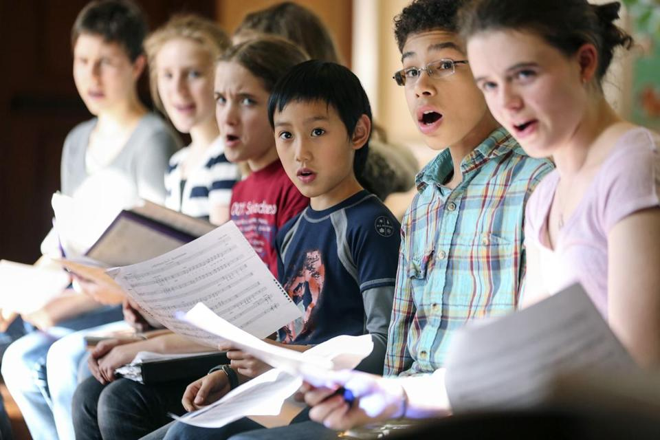 Participants sing during a rehearsal for the PALS Children's Chorus at First Parish Church in Brookline.