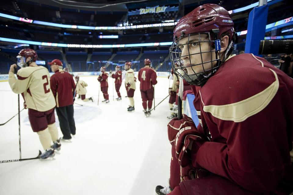 Boston College's Chris Kreider (19) watched his teammates participate in a drill during practice for the NCAA Frozen Four college hockey tournament.