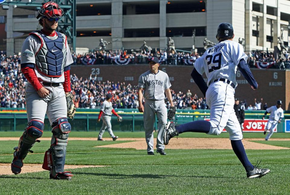 Red Sox catcher Jarrod Saltalamacchia (left) and pitcher Alfredo Aceves (center) walked off the field after Detroit's  Danny Worth scored the game-winning run.