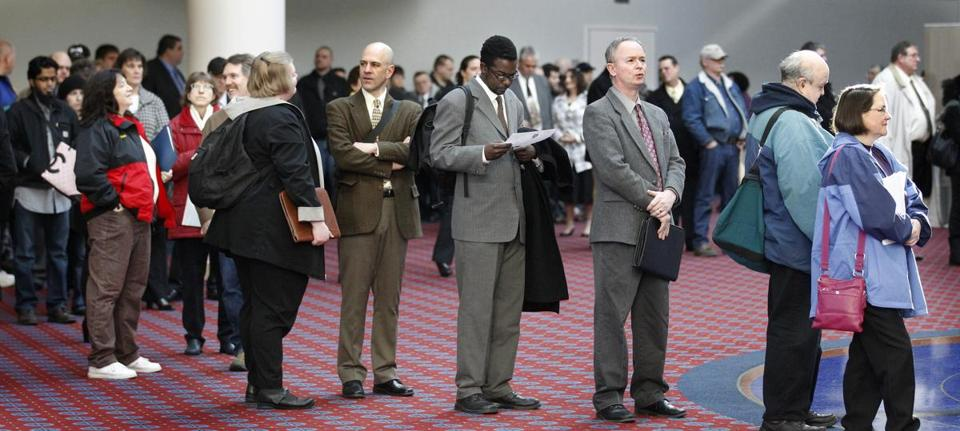 Job seekers stood in line at a job fair last month in Portland, Ore.