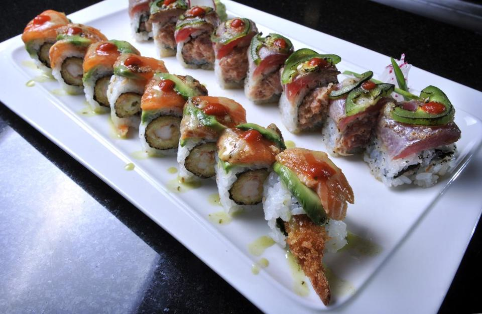 From left, the Coco Salmon and Wild Fire sushi rolls, as prepared at Moko in South Boston. The Coco Salmon is made with Cajun seasoned salmon, avocado with wasabi and basil sauce. The Wild Fire is made with seared tuna, jalapenos, garlic, and ponzu sauce.