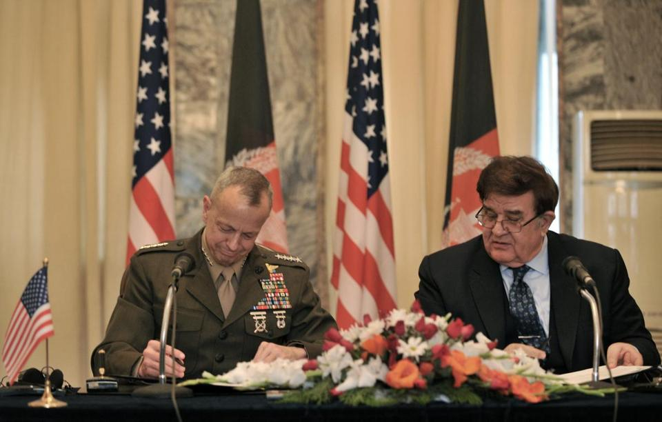 General John Allen, the US commander in Afghanistan, and Afghanistan Defence Minister Abdul Rahim Wardak signed an agreement Sunday in which Afghans will take the lead on controversial night raids.