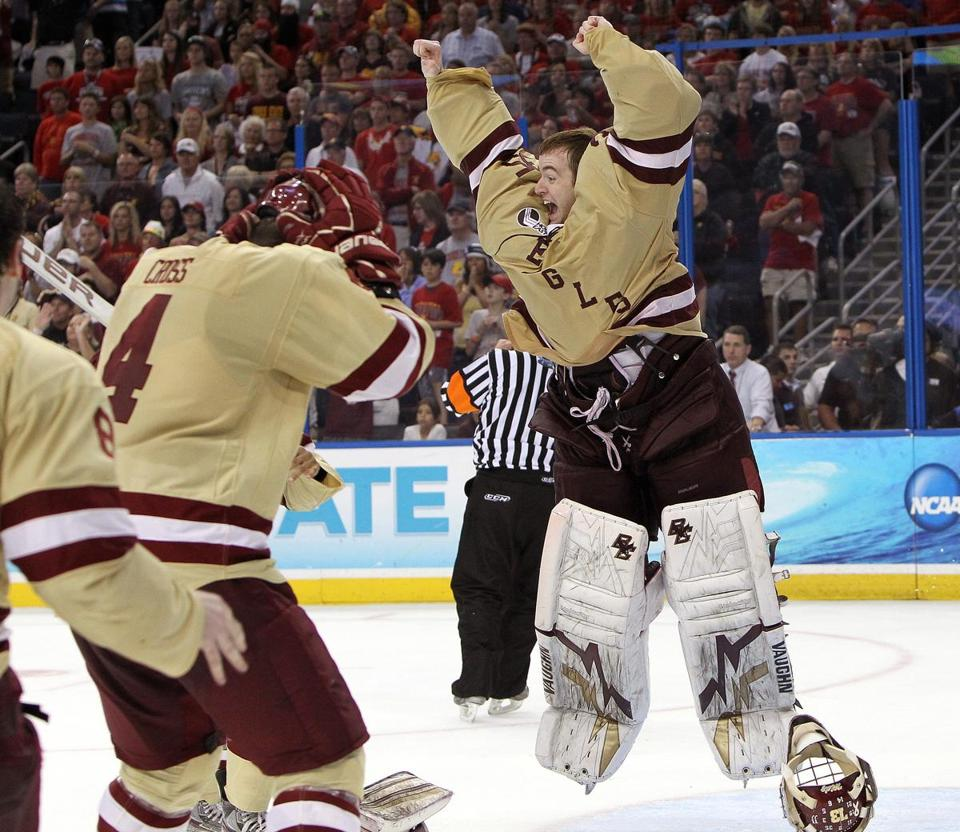 BC goaltender Parker Milner — the Frozen Four's Most Outstanding Player — jumps for joy with his teammates after the Eagles finished off Ferris State.