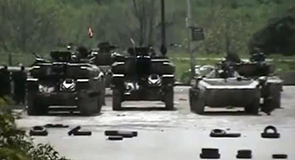 An image taken from a video on YouTube Monday showed Syrian tanks in the city of Homs. A peace plan was in jeopardy as fresh clashes raged.)