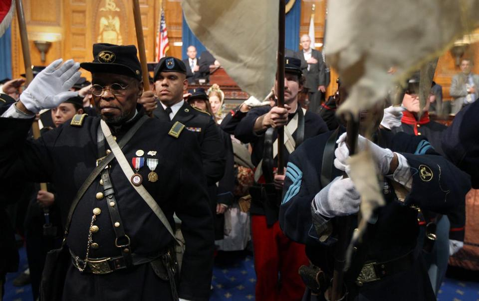 Benny White, left, and other Civil War reenactors were on hand at the State House Monday to help mark events commemorating the 150th anniversary of the Civil War.