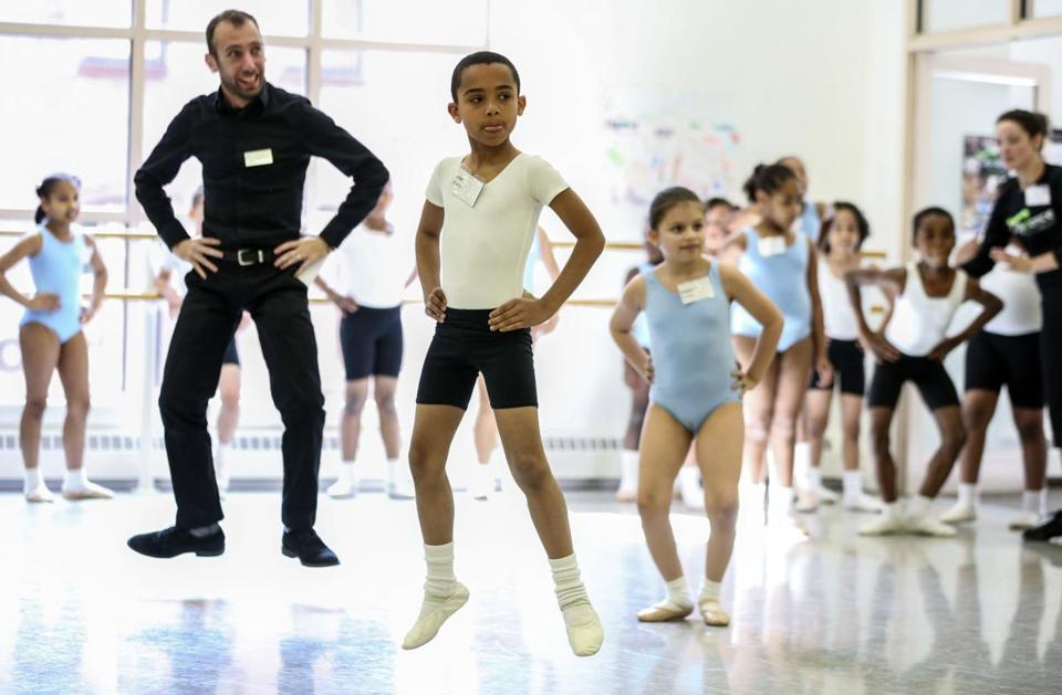 Citydance program manager Yo-el Cassell with students José Garcia and Madeline Romero.