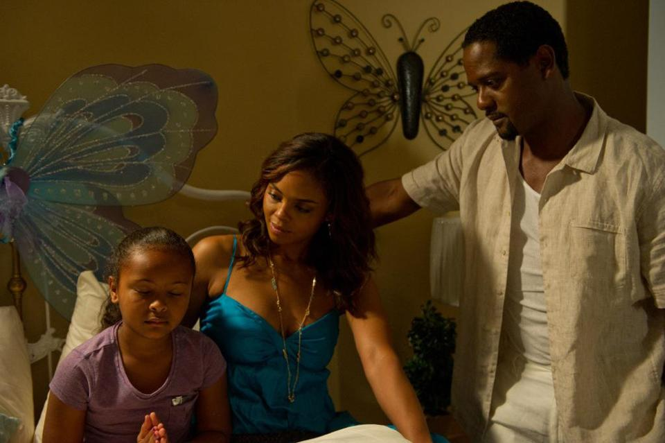 "From left: Zoe Carter, Sharon Leal, and Blair Underwood in ""Woman Thou Art Loosed: On the 7th Day.''"